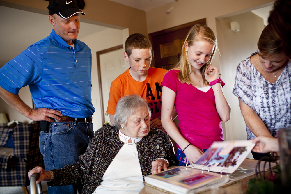 The Martin family (from left) -- David; Chris, 14; Lauren, 12; and LaDonna -- gather around AnnaBelle as they look through a photo album of a family vacation.