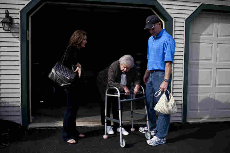 Kelley and her brother, David, wait for their grandmother to catch her breath as she moves from the living room to the car. AnnaBelle's mobility is significantly hampered by rheumatoid arthritis.