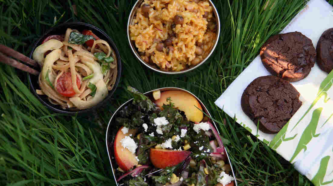 Picnic foods that were made to move: (clockwise from left) peanuty noodles, rice with pigeon peas, chocolate cookies and kale with peaches and feta.