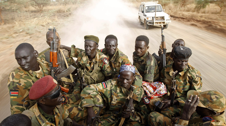 After decades of war, football signals hope. In this photo, South Sudanese soldiers travel by truck near the frontline with Sudan on April 24. (Reuters/Landov)