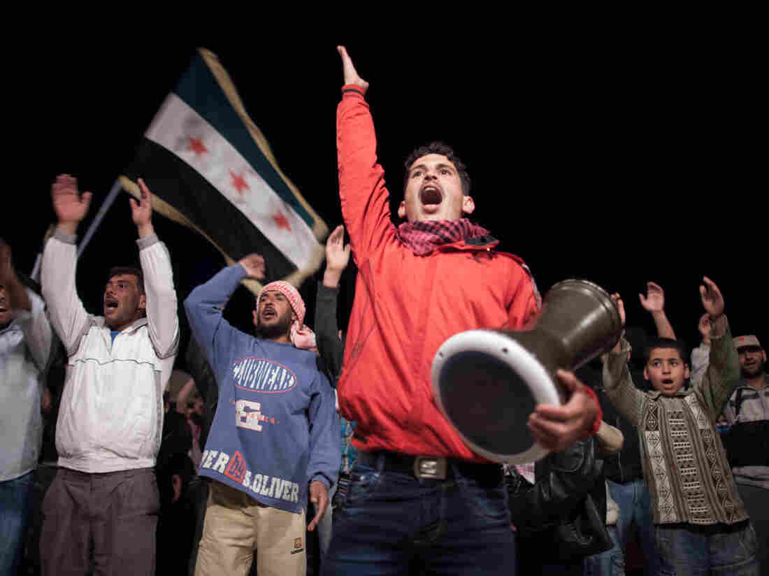 Syrians chant slogans during an anti-regime protest in Qusayr.