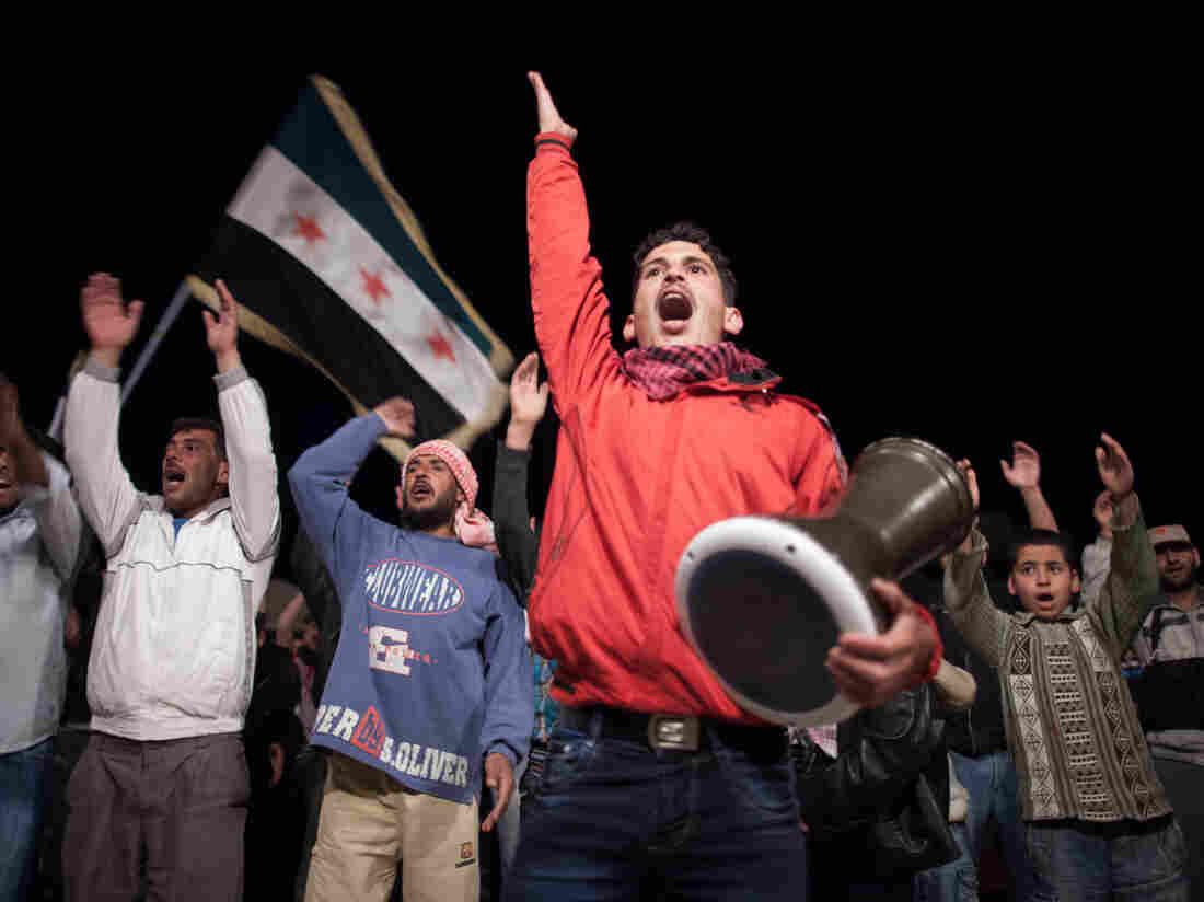 Syrians chant slogans during an anti-regime protest in Qusayr.