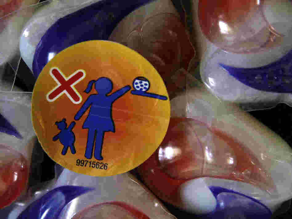 A label on a package of Tide laundry detergent packets warns parents to keep them away from children. Nearly 250 cases of illness from such packets have been reported to poison control centers this year.
