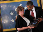 President Obama presents the Medal of Honor to Rose Mary Sabo, widow of Army Spc. Leslie Sabo. Sabo was awarded the nation's highest military decoration posthumously for his actions on May 10, 1970, while serving as a rifleman in Cambodia during the Vietnam War.