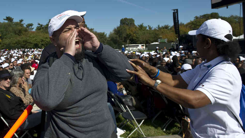 An unidentified heckler lets loose as President Obama begins a speech at the Martin Luther King memorial dedication in Washington, D.C., in October 2011.