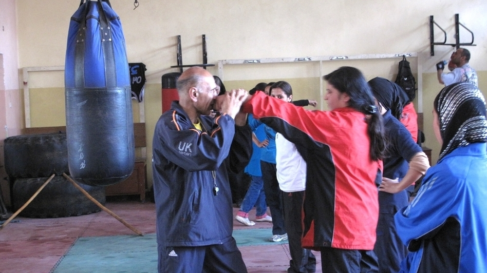 Saber Sharifi has been recruiting and training female boxers in Afghanistan over the past five years. He has often faced resistance from the families of the girls, but there are now 30 boxers on the team, and one will be going to the London Olympics this summer. (Ahmad Shafi for NPR)