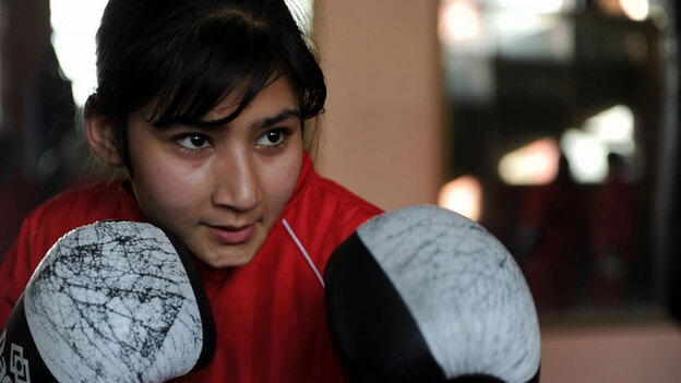 An Afghan girl takes part in a boxing training session around in a training room at the Kabul stadium, in Kabul in January 2011. (Getty Images)