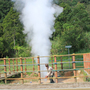 A local resident entertains visitors to the Kawah Kamojang geothermal field in West Java. He puts a length of bamboo to the steam coming from the ground to make a whistle, then throws soda cans into the vent, which shoots them high into the air. The Dutch colonial government drilled Indonesia's first geothermal wells at Kamojang in 1926, when the country was still known as the Dutch East Indies.