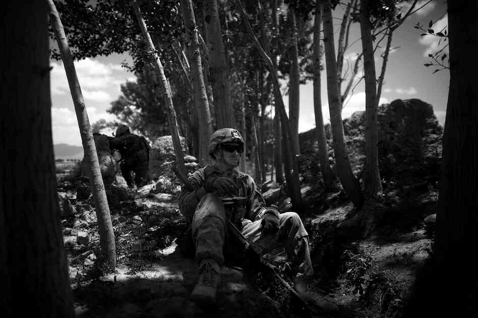 Sgt. Kyle Gonzales, a sniper with the 82nd Airborne, smokes a cigarette after a battle near the village of Babaker, Ghazni province. The soldiers have been engaged in gun battles every time they push into the hamlets north of their forward operating base.
