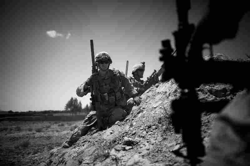 Sgt. Kyle Gonzales prepares to reposition himself during a battle near the village of Babaker.