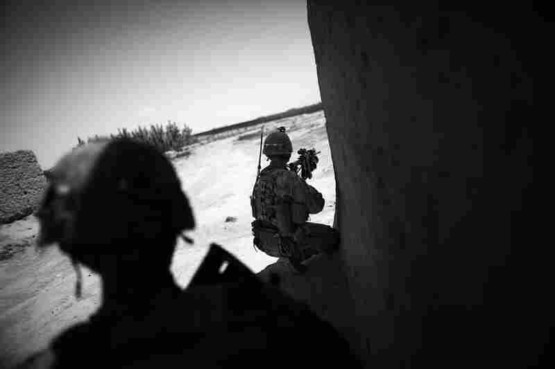 Soldiers try to spot the location of insurgents firing at them in Babaker.