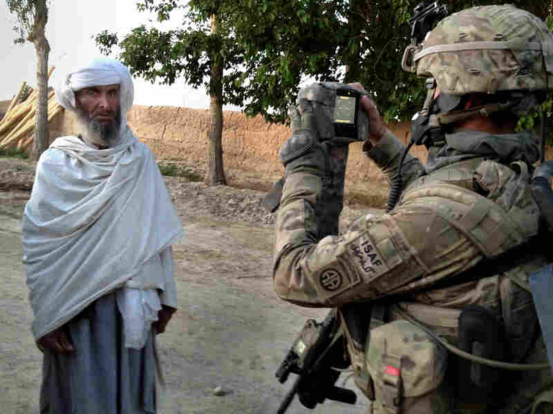 U.S. soldiers arrive early in the morning in the eastern village of Bagi Kheyl in an effort to surprise any potential Taliban. They walk through the village, taking down residents' information and searching for signs of the Taliban.