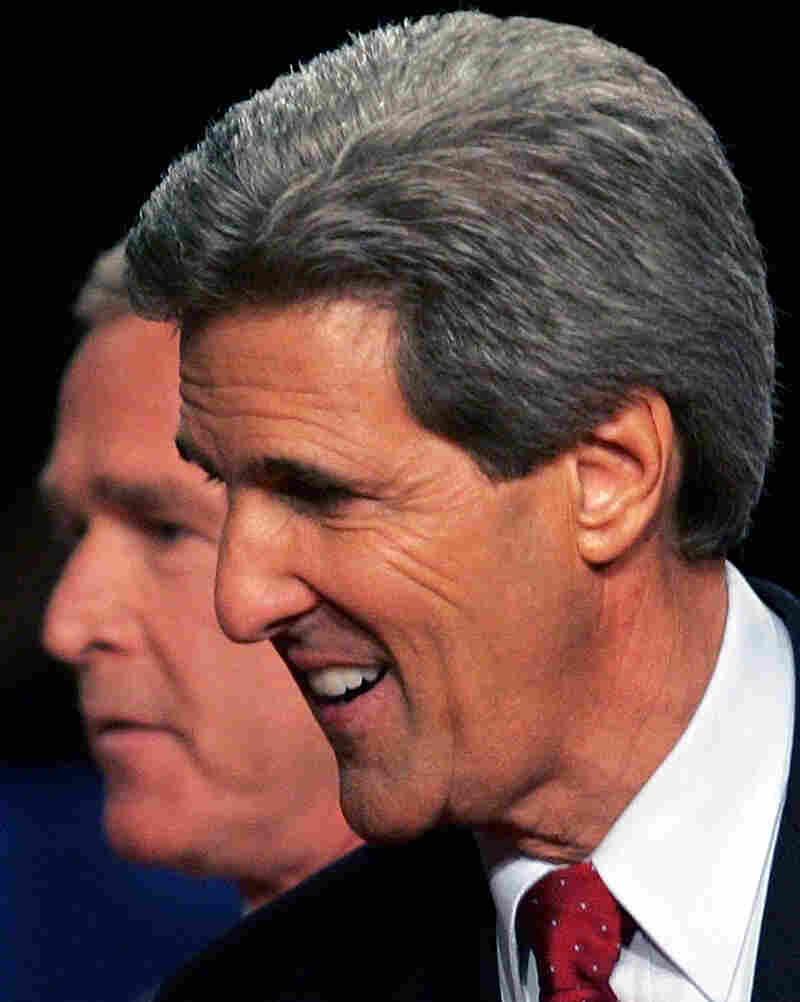 President George W. Bush passes behind Democratic challenger Sen. John Kerry, D-Mass., after a debate in Tempe, Ariz., in October 2004.