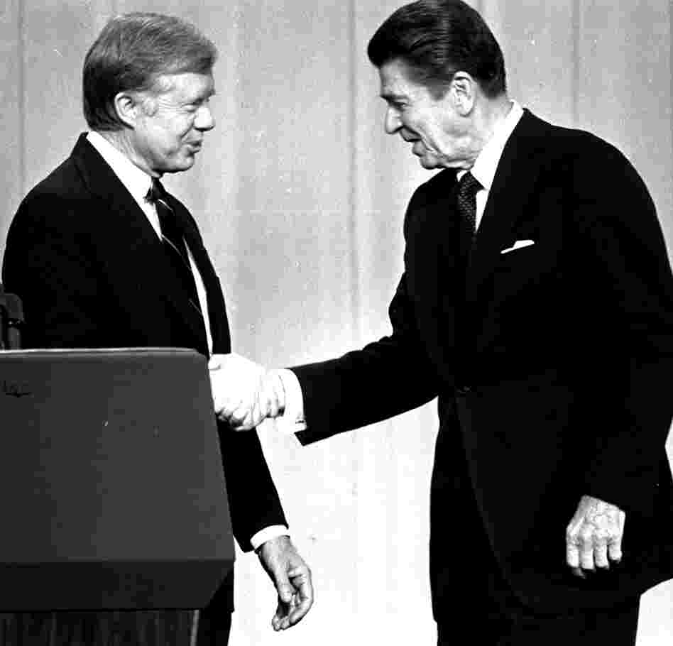 President Jimmy Carter shakes hands with Republican challenger Ronald Reagan before a debate in Cleveland in October 1980.