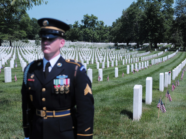 A U.S. Army honor guard stands at attention during a ceremony to mark Memorial Day, this week at Arlington National Cemetery.