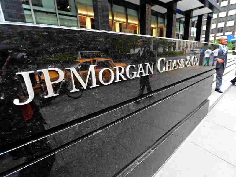 Men walk out of JPMorgan Chase & Co headquarters in New York, May 14, 2012.
