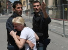 Two police officers in Mirandola try to comfort a woman after today's earthquake in Northern Italy.
