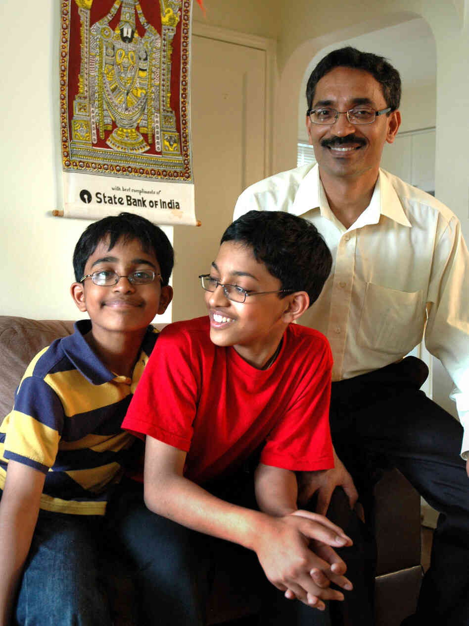 Arvind (center) and his younger brother, Srinath, spend hours tediously going through the dictionary.