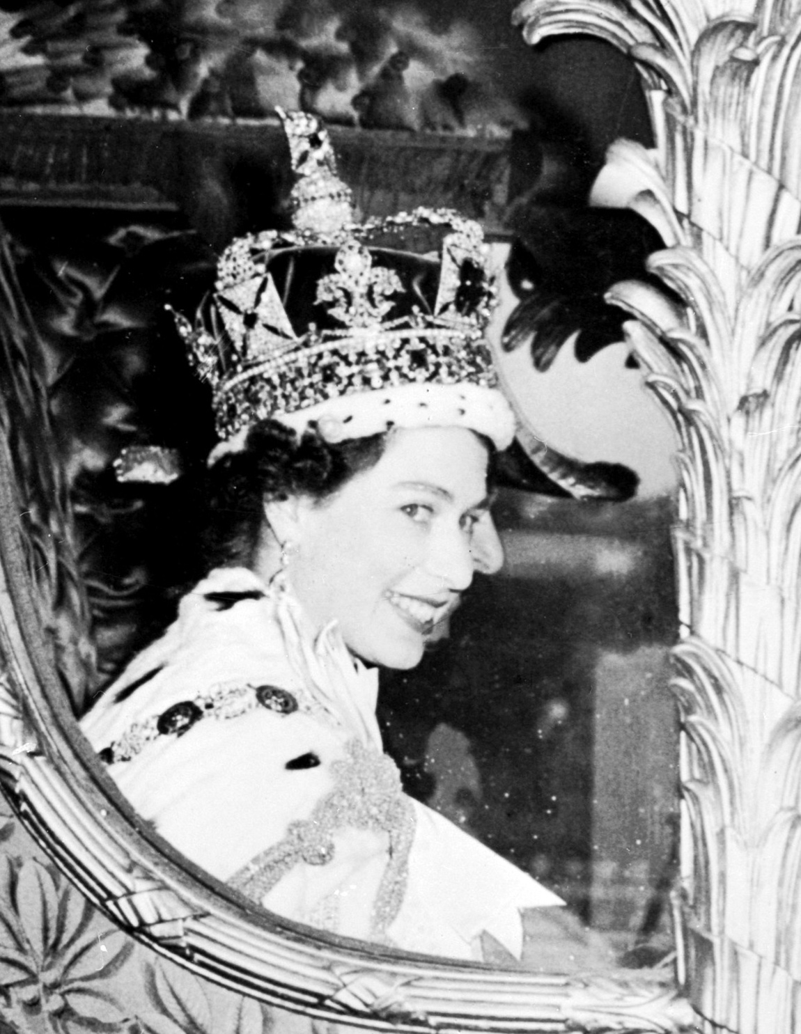 Queen Elizabeth II is seen after being crowned at Westminster Abbey in London on June 2, 1953. Elizabeth was proclaimed queen in 1952 at age 25.