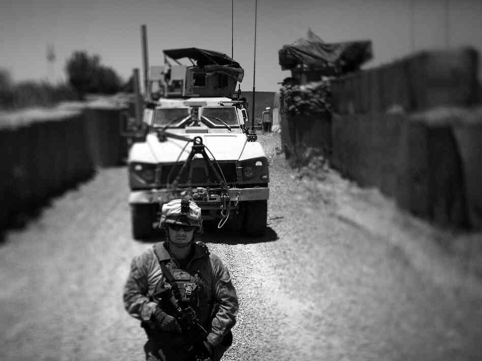 Marines with Echo Company of the Second Battalion, Ninth Marines out of Camp Lejeune, guide their M-ATV, a Mine Resistant Ambush Protected vehicle in to the district government compound in Marjah, Afghanistan.