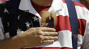 A demonstrator holds a copy of the U.S. Constitution to his chest as he attends a protest in downtown San Antonio on March 23.