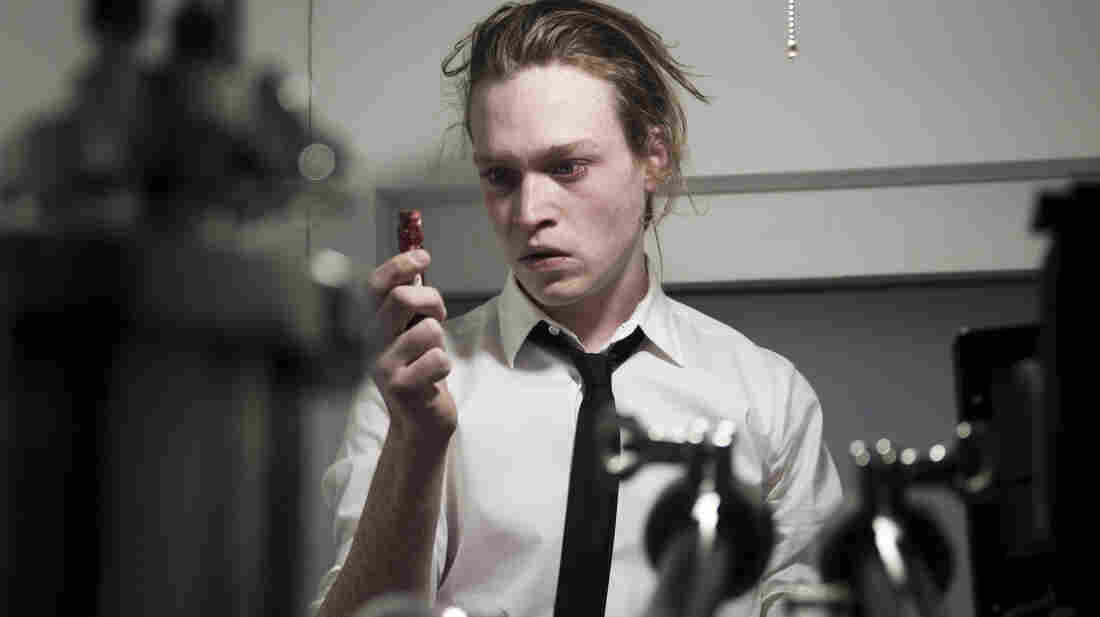 Caleb Landry Jones stars in Brandon Cronenberg's thriller Antiviral, which takes place in a dystopian future in which people inject themselves with viruses taken from celebrities.