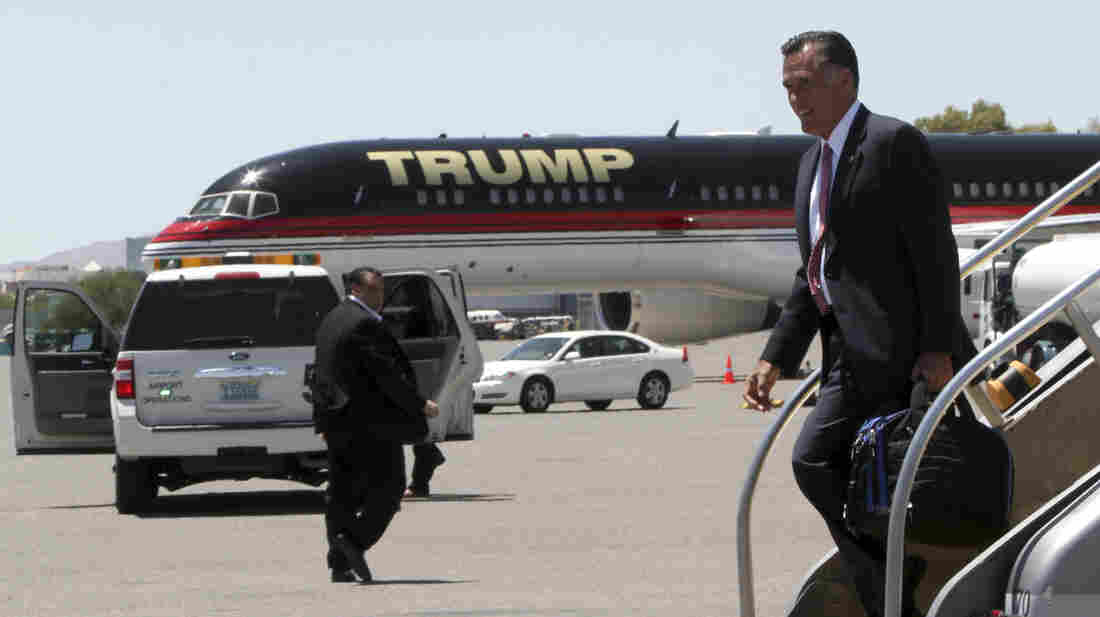 Republican presidential candidate Mitt Romney walks past Donald Trump's airplane as he arrives in Las Vegas on Tuesday, where he met with Trump for a fundraiser.