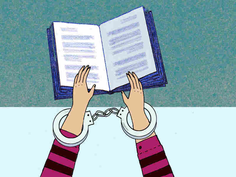 Illustration: Handcuffed hands hold a book.