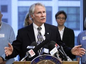 Oregon Gov. John Kitzhaber is leading a $2 billion health care experiment in the state, aimed at changing the way the sickest people in Oregon get health care. Here, he speaks during a press conference in Portland on May 4.
