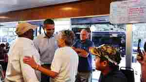 President Obama greets diners at Reid's House Restaurant in Reidsville, N.C., last fall. While there, he talked to a college student about the importance of education — one of the ideas Obama comes back to often.