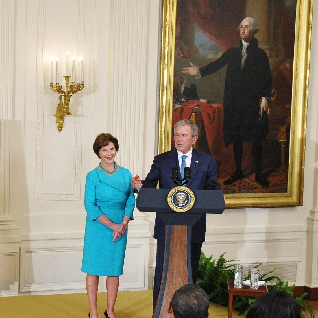 Former president George W. Bush and his wife Laura Bush speak during the unveiling of their portraits in the East Room of the White House in Washington, DC.