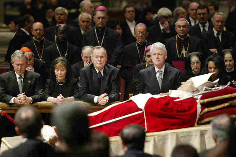 Former presidents often gather for significant events, such as funerals of heads of state and other major figures. Here, President George W. Bush, his wife Laura, former President George H.W. Bush, former President Bill Clinton, and Secretary of State Condoleezza Rice kneel by the body of Pope John Paul II inside St. Peter's Basilica, at the Vatican, on April 6, 2005.