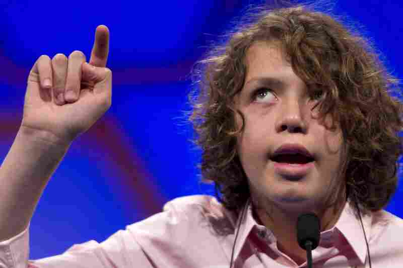 Sam Lowery, of Charlestown, Mass., spells his word in the air during Round 2 of the National Spelling Bee in Oxon Hill, Md., on Wednesday.