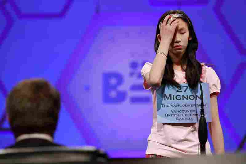 Mignon Tsai, 12, of Abbotsford, British Columbia, Canada, reacts as she misspells a word during Round 5 of the semifinals on Thursday.