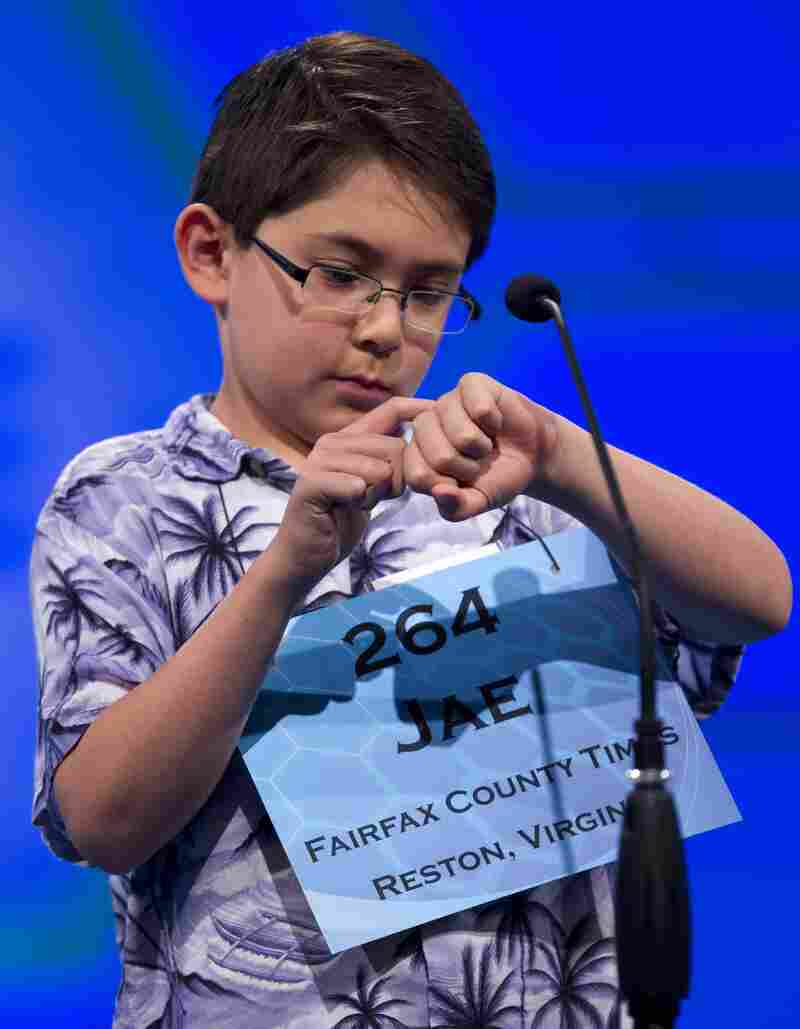 """Jae Canetti of Fairfax, Va., concentrates on his word """"habendum"""" during the semifinal round on Thursday."""