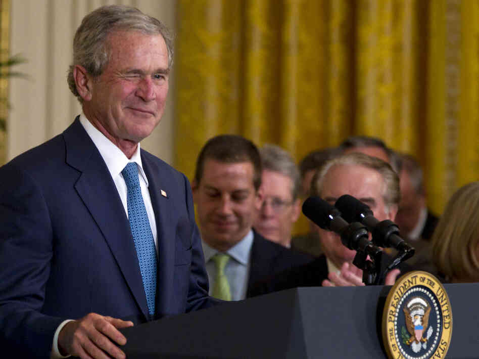Former President George W. Bush winks in the East Room of the White House on Thursday during a ceremony to unveil his portrait.
