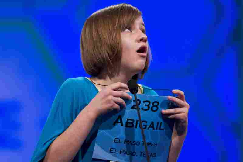"""Abigail Violet Spitzer of El Paso, Texas, reacts after spelling her word """"tondino"""" correctly during Thursday's semifinal round."""