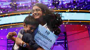 "With confetti falling, Snigdha Nandipati, 14, is embraced by her brother, Sujan Nandipati, after she won the National Spelling Bee with the word ""guetapens"" Thursday."