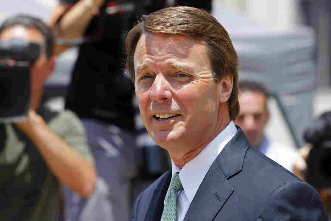 John Edwards leaves a federal courthouse during the ninth day of jury deliberations in his trial on charges of campaign corruption in Greensboro, N.C., on Thursday.