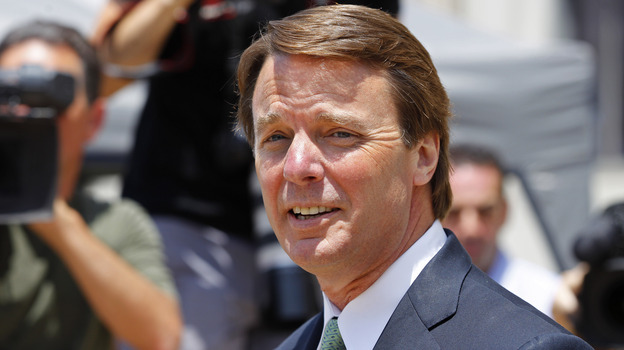John Edwards leaves a federal courthouse during the ninth day of jury deliberations in his trial on charges of campaign corruption in Greensboro, N.C., on Thursday. (AP)