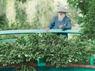 Claude Monet observes his Giverny, France, garden from its Japanese footbridge in this 1922 colorized.