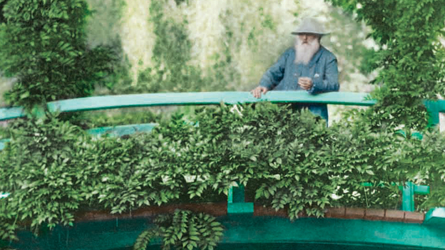 Claude Monet observes his Giverny, France, garden from its Japanese footbridge in this 1922 colorized. (Courtesy of the New York Botanical Garden)