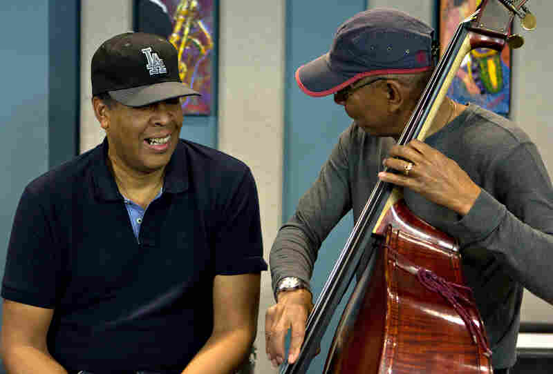 """Jack DeJohnette messes around with Stanley Clarke's bass after performing Victor Feldman's """"Joshua."""""""