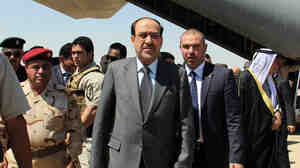 Iraqi Prime Minister Nouri al-Maliki (center) arrives on May 8 at Kirkuk airport in northern Iraq, on his first visit to the multi-ethnic city since taking office.