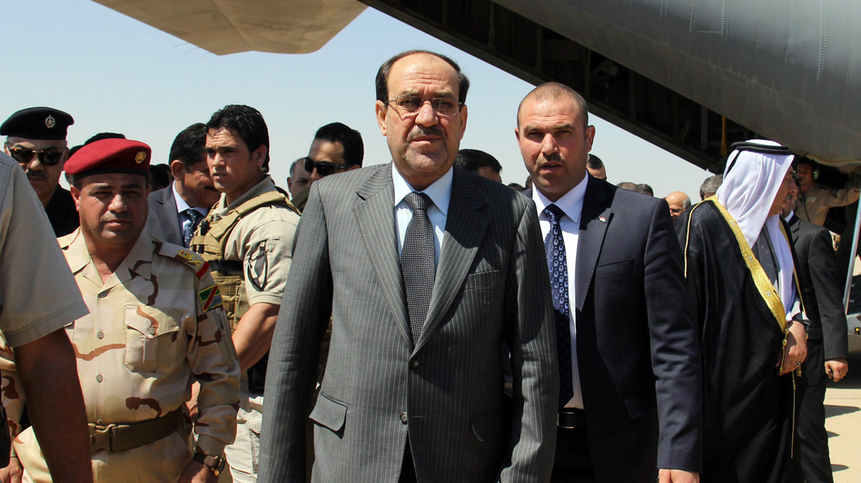 Iraqi Prime Minister Nouri al-Maliki (center) arrives on May 8 at Kirkuk airport in northern Iraq, on his first visit to the multi-ethnic city since taking office. (Marwan Ibrahim/AFP/Getty Images)