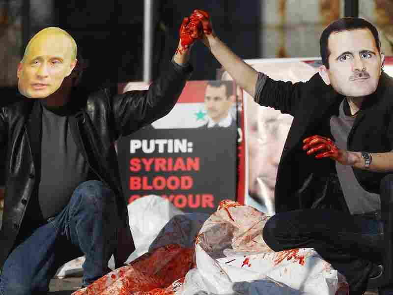 Actors wearing masks of Syrian President Bashar Assad and Russian Prime Minister Vladimir Putin perform with body bags during a demonstration outside United Nations headquarters on January 24, 2011 in New York City. Protesters called on the U.N. Security Council to pass a resolution to attempt to halt Assad's crackdown on the Syrian uprising.