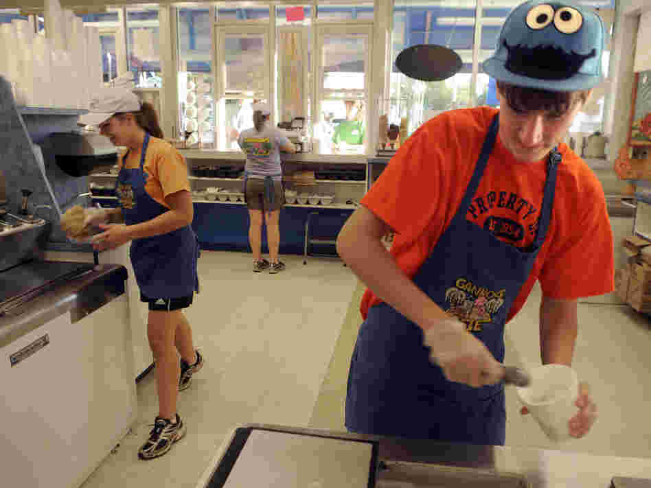 Tom Auffhammer, 17 (right) scoops ice cream in Syracuse, N.Y. Teens continue to face stiff competition for summer jobs, but a downward trend in summer hiring for teens actually predates the recession.