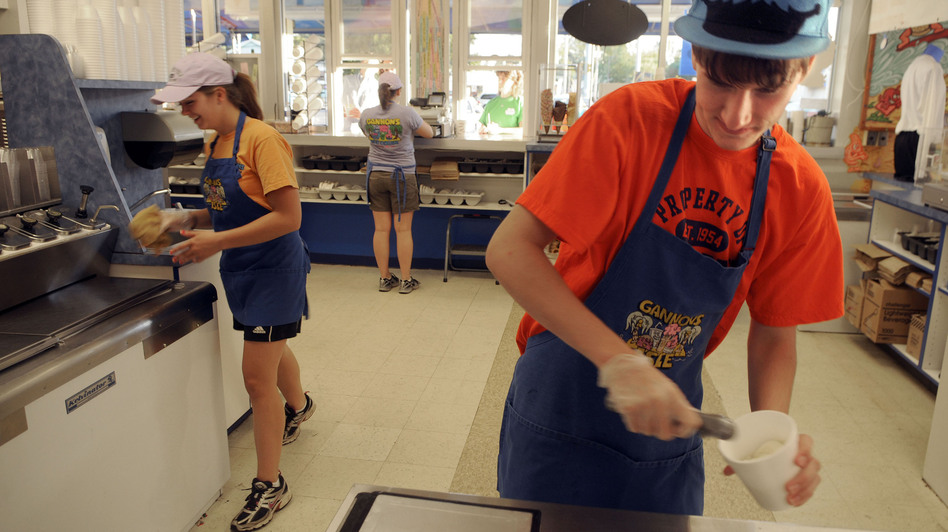 Tom Auffhammer, 17 (right) scoops ice cream in Syracuse, N.Y. Teens continue to face stiff competition for summer jobs, but a downward trend in summer hiring for teens actually predates the recession. (The Post-Standard/Landov)