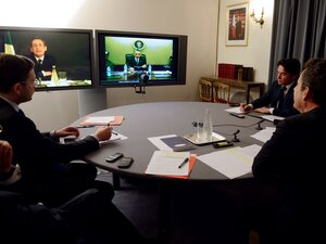 Former French President Nicolas Sarkozy (R) and Elysee's diplomatic adviser for U.S. Damien Loras (2ndR) take part in a video conference with President Barack Obama (on screen) focused on Syria, Iran and Afghanistan situations, at the Elysee palace on April 12, 2012 in Paris.