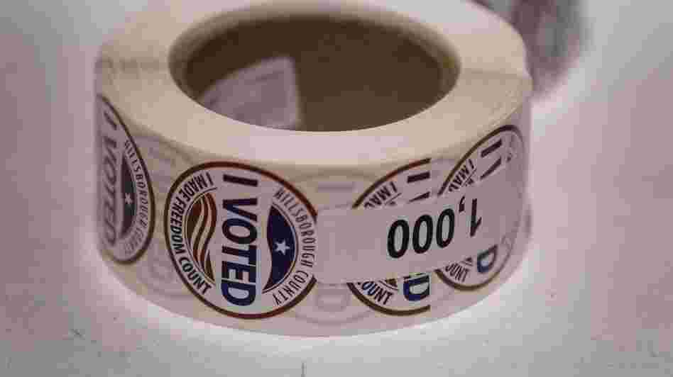 """I Voted"" stickers are left ready for voters at a polling station on Jan. 31, the day of Florida's presidential primary, in Tampa."